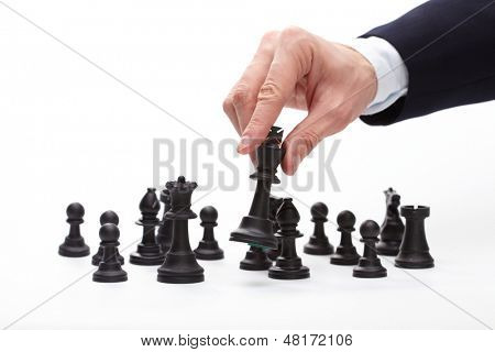 Business man moving chess figure
