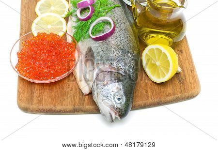 Fish Trout, Salmon Roe, Vegetables And Spices On A White Background - Top View
