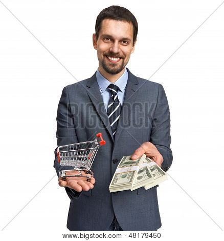Successful businessman proposes stacks of dollar bills for shopping isolated on white background
