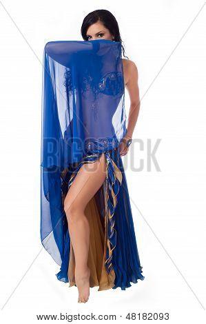 Belly Dancer Peeking Behind A Blue Veil