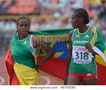 DONETSK, UKRAINE - JULY 14: Ansa (left) and Mohamed of Ethiopia with national flag after the final of 2000 m steeplechase during 8th IAAF World Youth Championships in Donetsk, Ukraine on July 14, 2013
