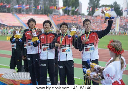 DONETSK, UKRAINE - JULY 14: Team Japan win bronze in the medley relay during 8th IAAF World Youth Championships in Donetsk, Ukraine on July 14, 2013. Right to left: Yui, Yamaki, Nagata, Oda