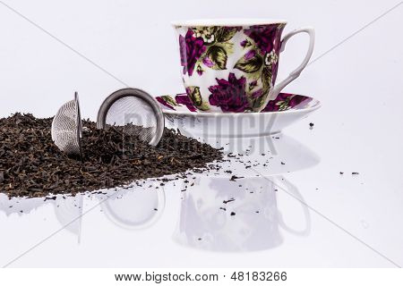 Cup And Black Tea On White Background.