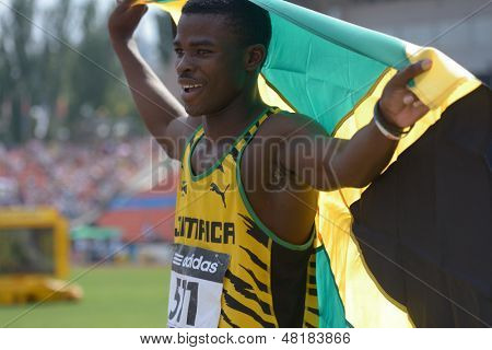 DONETSK, UKRAINE - JULY 14: Gold medalist in 200 metres Michael O'Hara of Jamaica with national flag during 8th IAAF World Youth Championships in Donetsk, Ukraine on July 14, 2013
