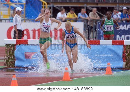 DONETSK, UKRAINE - JULY 14: Girls compete in the final of 2000 metres steeplechase during 8th IAAF World Youth Championships in Donetsk, Ukraine on July 14, 2013
