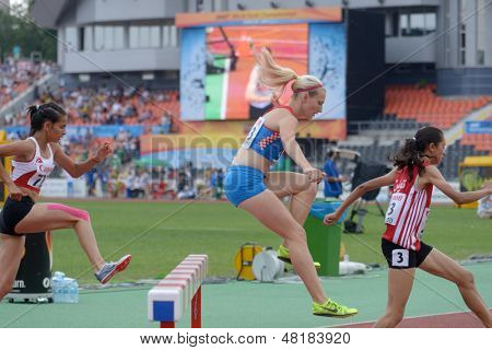 DONETSK, UKRAINE - JULY 14: Girls compete in the final of 2000 m steeplechase during 8th IAAF World Youth Championships in Donetsk, Ukraine on July 14, 2013