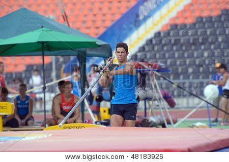 DONETSK, UKRAINE - JULY 14: Lev Skorish of Israel competes in the final in pole vault during 8th IAAF World Youth Championships in Donetsk, Ukraine on July 14, 2013