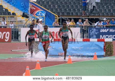 DONETSK, UKRAINE - JULY 14: Chepngetich (left), Jepkemei (right), both Kenya, and Ansa, Ethiopia compete in steeplechase during 8th IAAF World Youth Championships in Donetsk, Ukraine on July 14, 2013