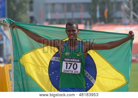 DONETSK, UKRAINE - JULY 14: Silver medalist in 200 metres Vitor Hugo dos Santos of Brazil with national flag during 8th IAAF World Youth Championships in Donetsk, Ukraine on July 14, 2013