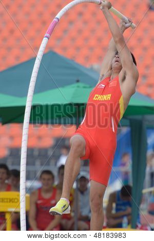 DONETSK, UKRAINE - JULY 14: Bokai Huang of China fight for his silver medal in the final in pole vault during 8th IAAF World Youth Championships in Donetsk, Ukraine on July 14, 2013