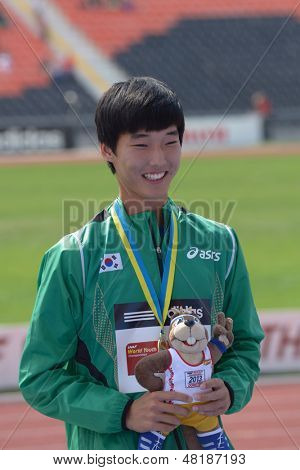 DONETSK, UKRAINE - JULY 14: Sanghyeok Woo of Korea with his gold medal in high jump during 8th IAAF World Youth Championships in Donetsk, Ukraine on July 14, 2013