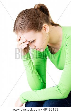 Young beautiful woman in depression. Isolated on white background.