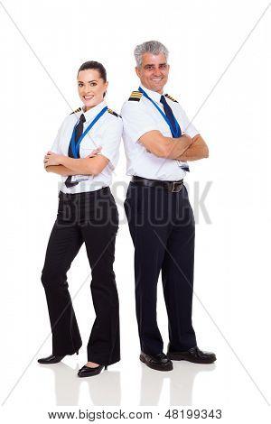 senior pilot and female co-pilot full length portrait on white