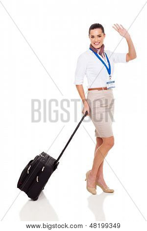 cheerful young airhostess waving goodbye isolated on white