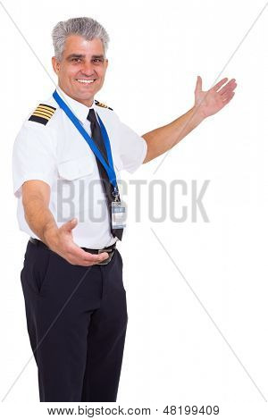 handsome senior airline pilot welcome gesture on white background