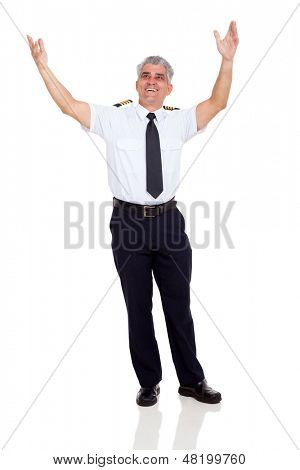 cheerful senior commercial airline pilot arms up