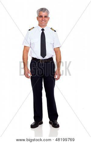 smiling senior airline pilot standing on white background