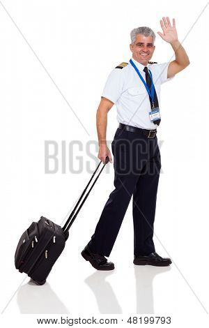mid age airline pilot waving goodbye on white background