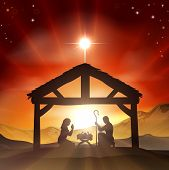 stock photo of manger  - Christmas Christian nativity scene with baby Jesus in the manger in silhouette and star of Bethlehem - JPG