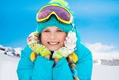 image of ten years old  - Mountain skier ten years old girl laying in snow with mountains on background  - JPG