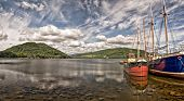 picture of bute  - Two boats sit berthed on the scenic location of Loch Fyne at the Scottish town of Inverary.