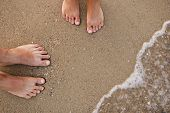 pic of wet feet  - loving couple feet in the sand on the beach - JPG