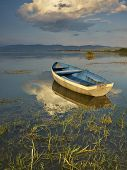 stock photo of macedonia  - Boat on sunset in the lake of Dojran - JPG