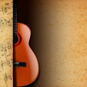 image of bluegrass  - Acoustic brown guitar with yellow and brown stained paper and musical notes blurred - JPG