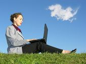 Businesswoman Sit With Notebook On Blue Sky With Cloud poster