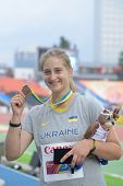 DONETSK, UKRAINE - JULY 13: Valeriia Semenkova of Ukraine with her bronze medal in hamer throw on th