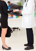 stock photo of rep  - medical rep bribing doctor - JPG