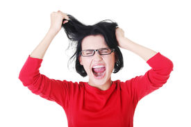 stock photo of crazy face  - Woman stressed is going crazy pulling her hair in frustration - JPG