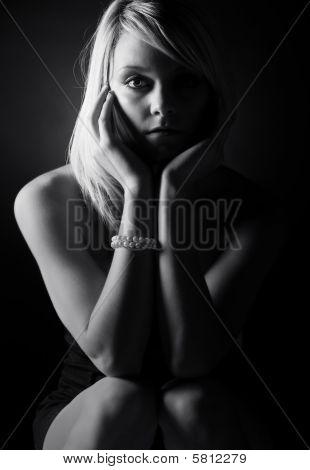 Low Key Shot Of A Beautiful Blonde Teenage Girl