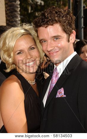 Michael Urie and friend  at the 2007 Primetime Creative Arts Emmy Awards. Shrine Auditorium, Los Angles, CA. 09-08-07
