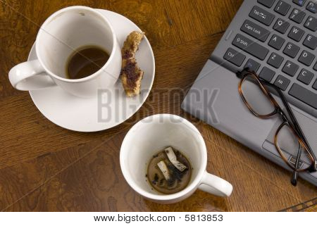 Coffee Mugs And Stress With Laptop