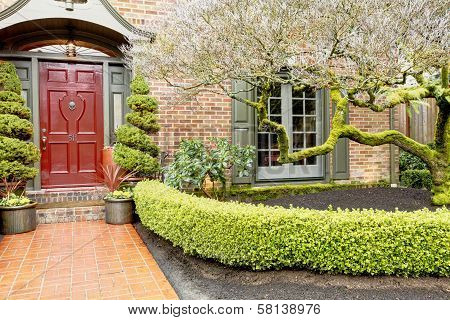 Classic Brick House Entrance With Trim Hedge