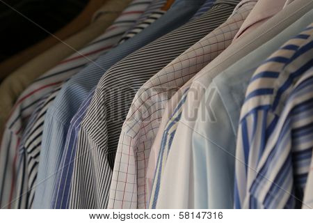 Hanging Shirts Of Businessman