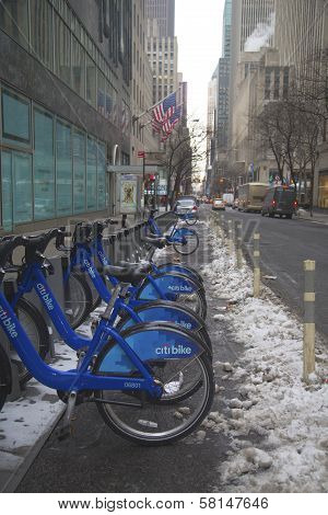 Citi bike station under snow near Times Square in Manhattan