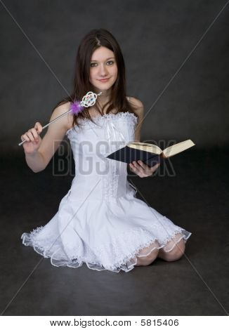 Girl - Fairy In A White Dress With Magic Wand And Book