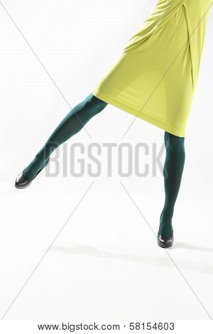 Female legs in colorful tights
