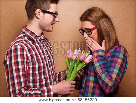 Man Giving Bouquet Girl. Valentine's Day