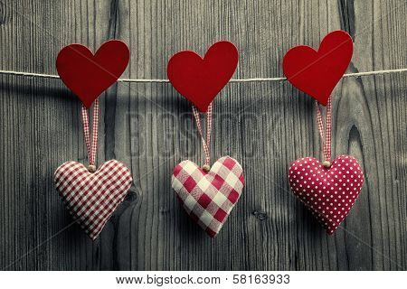 Textile hearts hanging on the rope - Valentine's Day background