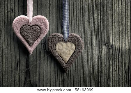 Heart-shaped biscuits with two colors - wood background