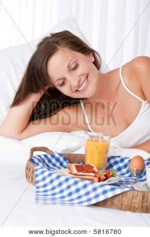 Happy Woman In White Bed Having Breakfast