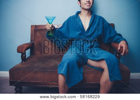 Happy Young Man In Dressing Gown Drinking Martini