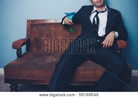 Relaxed Businessman Drinking After Work