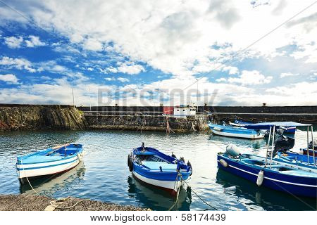 Fishing Boat Moored At The Harbor Of Acitrezza, Sicily