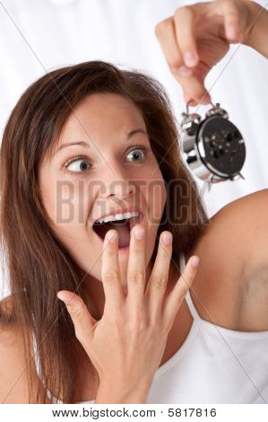 Surprised Woman Watching Alarm Clock