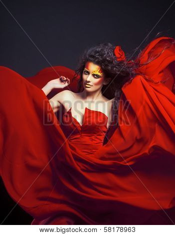 Sexy woman in fluttering red dress