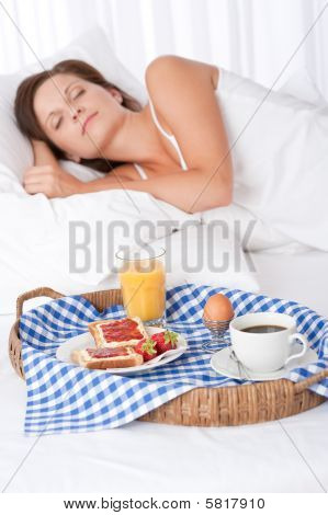 Woman Sleeping In White Bed, Breakfast In Foreground